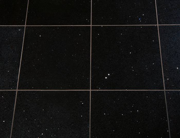 Shiny black floor tiles